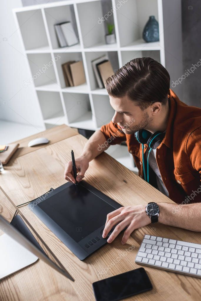 young designer working with computer and drawing tablet