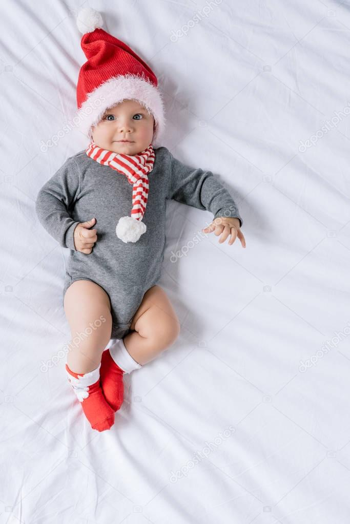 infant boy in santa claus hat