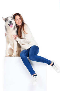 beautiful cheerful girl hugging husky dog, isolated on white