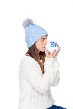 Beautiful woman in knitted hat and winter sweater drinking coffee, isolated on white stock vector