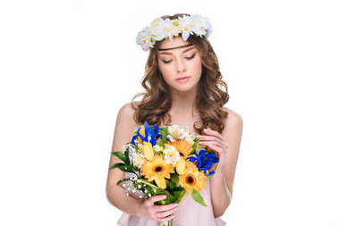 young woman in floral wreath with bouquet isolated on white