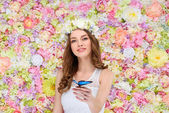 Photo beautiful young woman in floral wreath with butterfly on hand