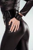Fotografie Hand des Gesäßes attraktiven heiße Mädchen in Catsuit isoliert auf weiss