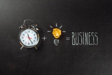 light bulb symbol and alarm clock
