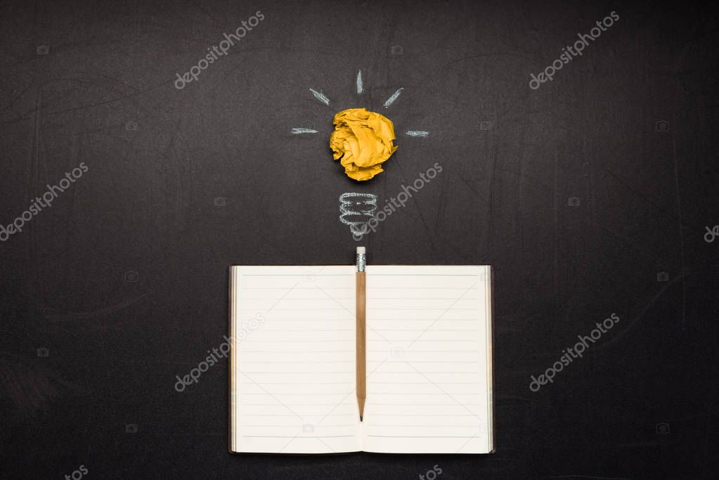 light bulb symbol and notebook