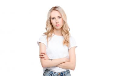 Young woman with arms crossed