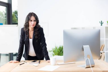 pregnant businesswoman looking at computer