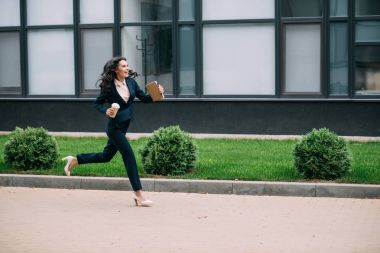 businesswoman running to work