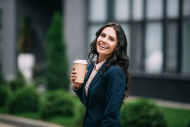 businesswoman with disposable cup of coffee
