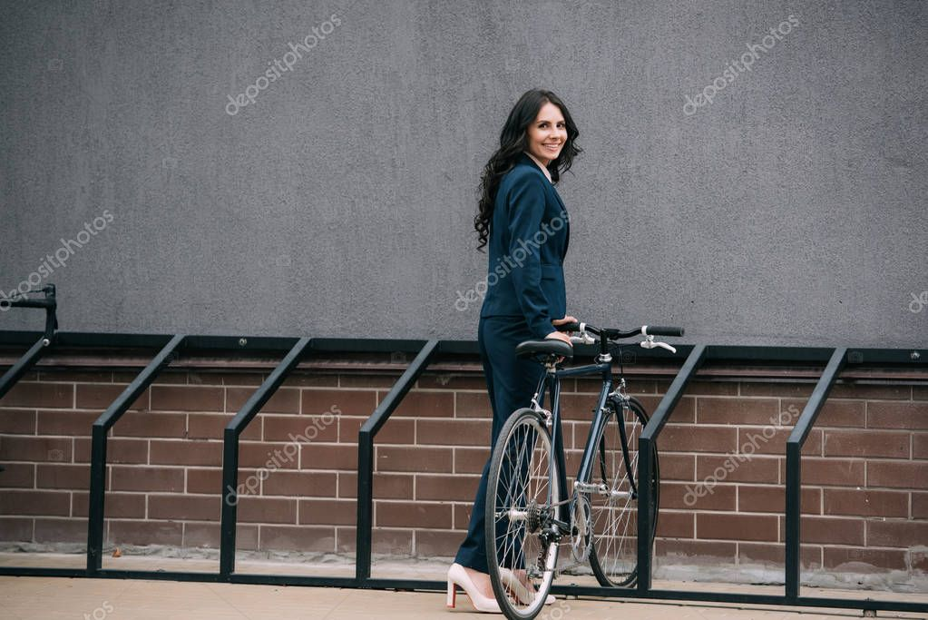 businesswoman parking bicycle