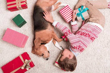 boy with beagle dog and christmas gifts