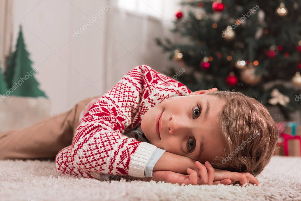 boy in christmas decorated room
