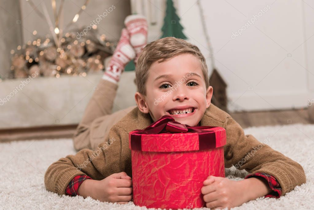 boy laying on floor with gift