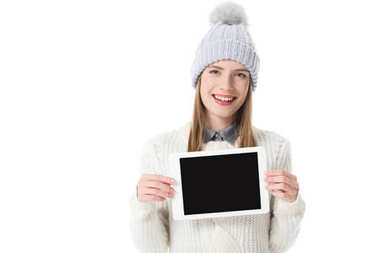 Attractive girl in winter clothes holding digital tablet with blank screen,  isolated on white stock vector