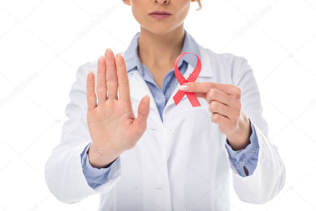 doctor with aids ribbon showing stop