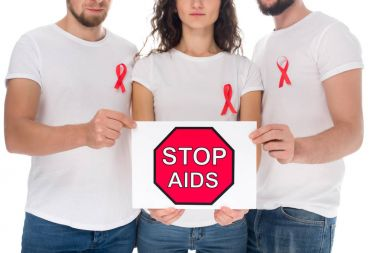 people with stop aids banner