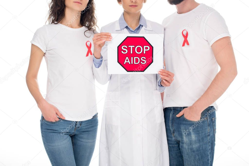 couple and doctor with stop aids placard