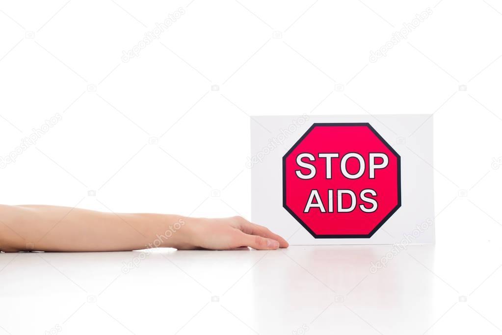 dead body near stop aids banner