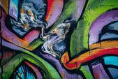 színes graffitik a falon City, street art, közelről