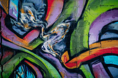 close up of colorful graffiti on wall in city, street art