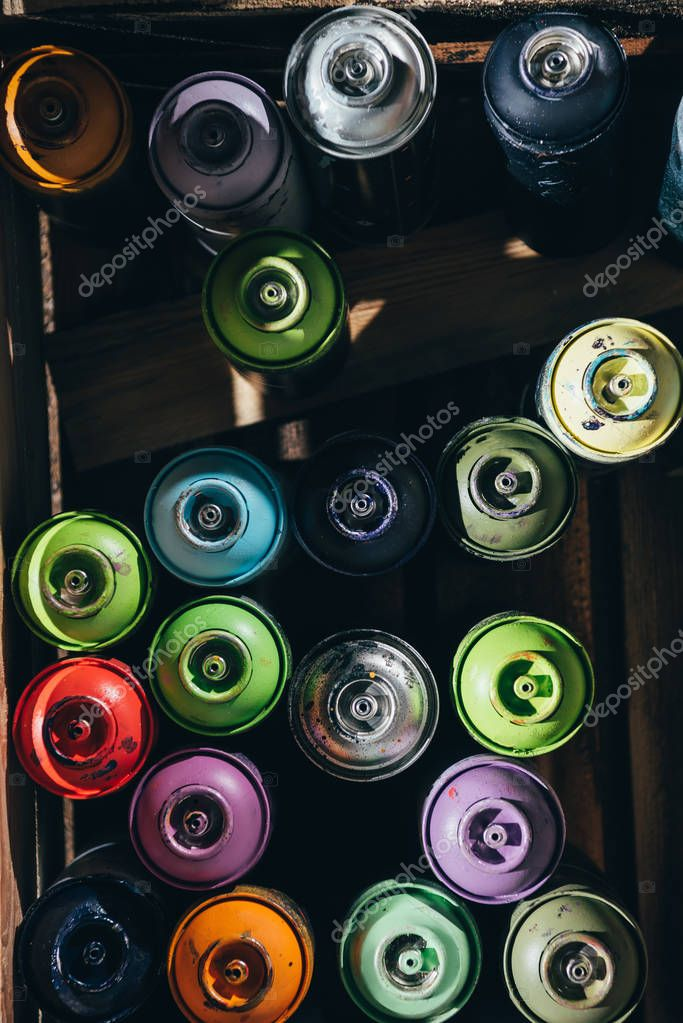 top view of cans with colorful aerosol paint