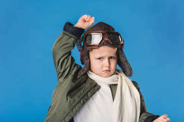 Portrait of preteen boy in pilot costume isolated on blue stock vector
