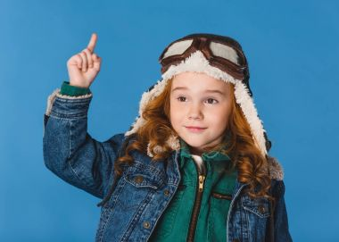 portrait of adorable preteen kid in pilot costume isolated on blue