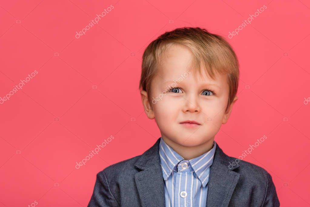 portrait of adorable little boy isolated on pink