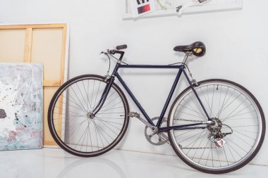 Bicycle by the wall in stylish light room