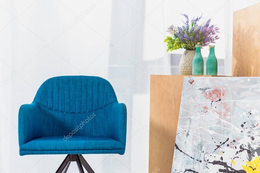 Blue modern chair in modern light room