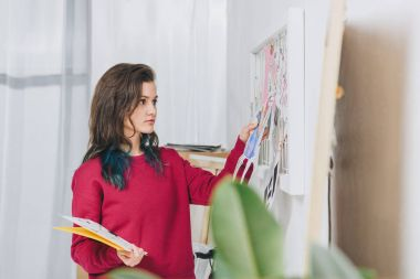 Young woman creating mood board
