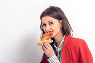 Young woman eating pizza on white background stock vector