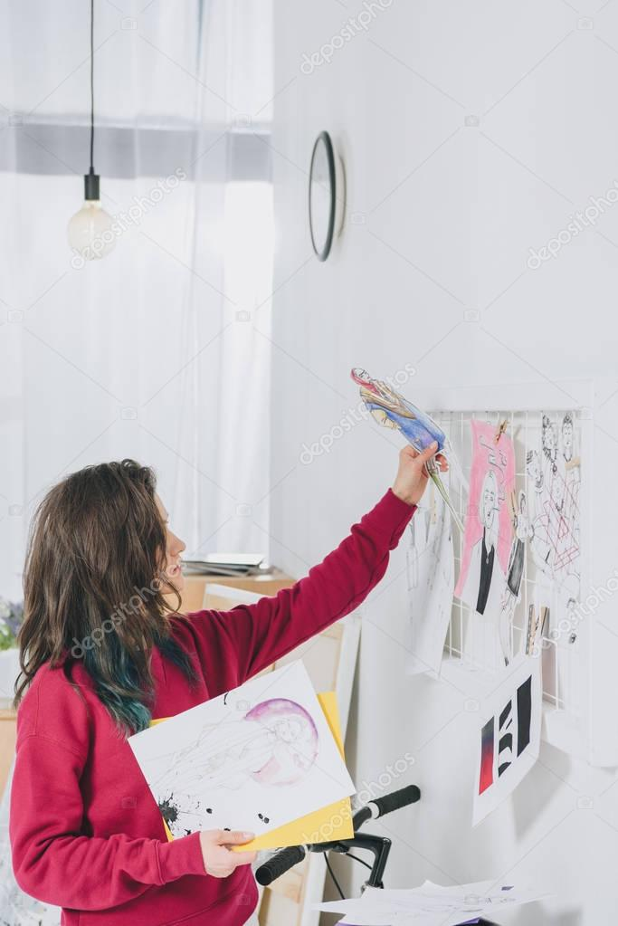 Attractive young girl creating mood board