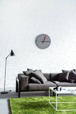 Digital gadgets in cozy interior with modern grey sofa