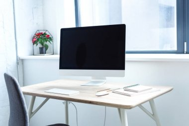 Blank screen of computer on working table stock vector