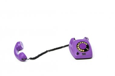 close-up view of violet rotary telephone isolated on white