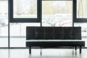 leather black sofa in empty business office
