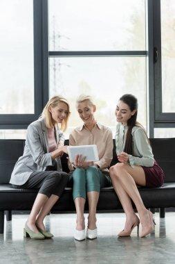 beautiful businesswomen using tablet in office