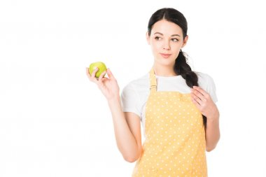 attractive woman in apron holding apple in hand isolated on white background