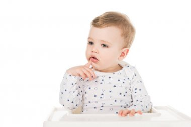 Little boy sitting in highchair isolated on white background stock vector