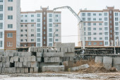 Construction site with concrete blocks and heavy machinery