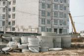 Construction site with building crane and concrete blocks