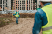 Fotografie Selective focus of surveyors measuring land on construction site