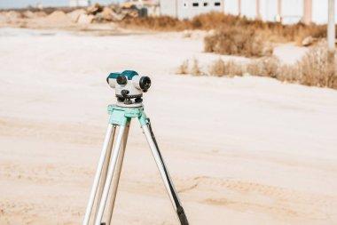 Digital level for geodesy measuring on dirt road stock vector