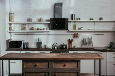 Interior of modern kitchen with wooden table
