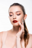 pretty young woman with bright red lips touching face isolated on white