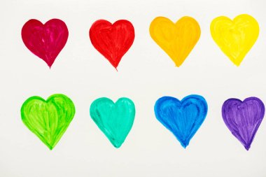 Painted and colorful hearts isolated on white stock vector