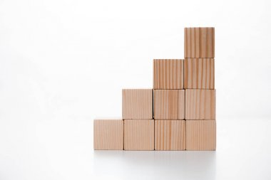 Wooden cubes on white with copy space stock vector