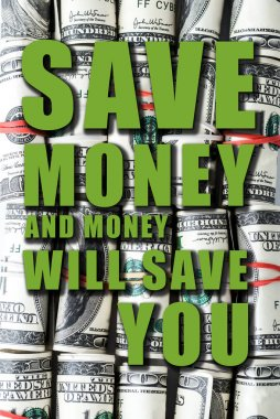 top view of cash rolls with colorful rubber bands near save money and money will save you letters