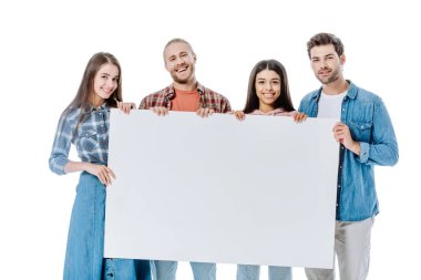 Happy multicultural friends holding blank placard isolated on white stock vector